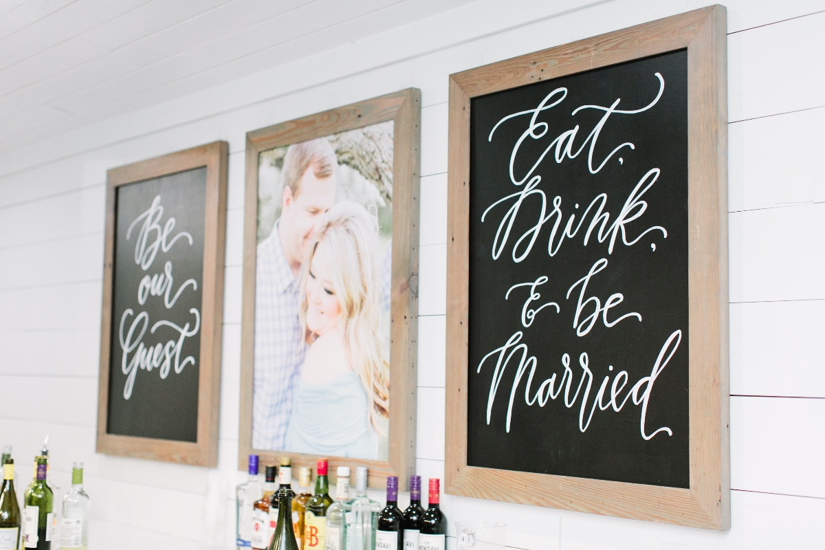 decorate the bar with engagement photo and cute signs