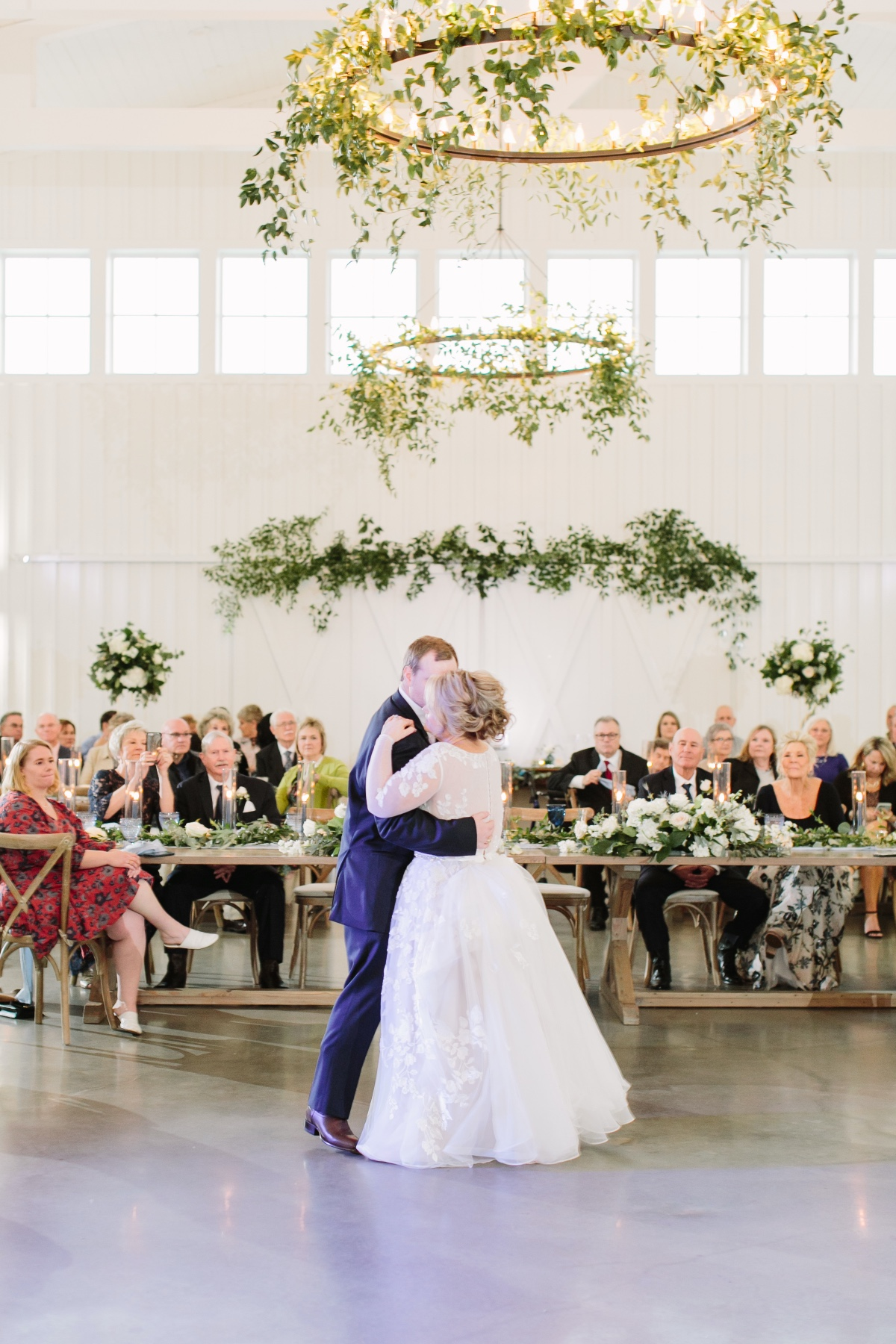 photo of the bride and groom taking their first dance as married couple