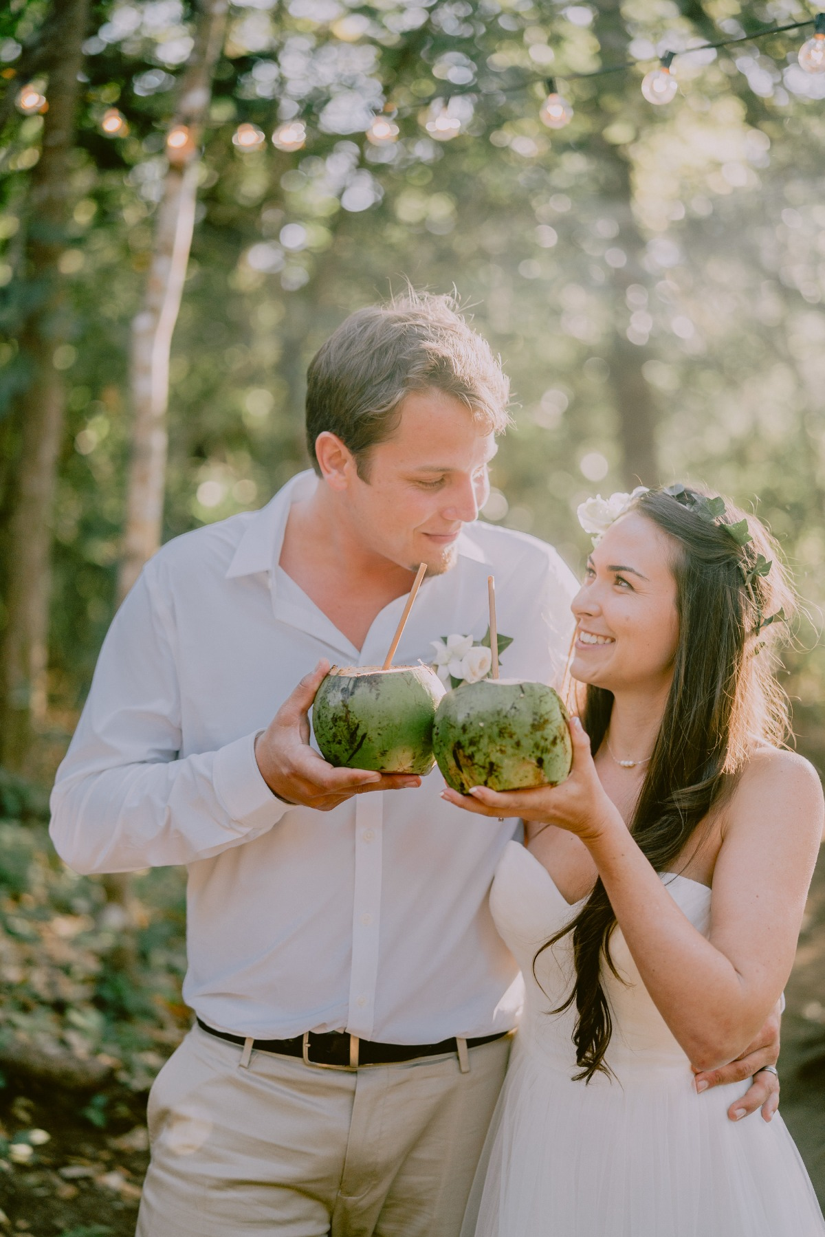 Bride and Groom sharing tropical drinks