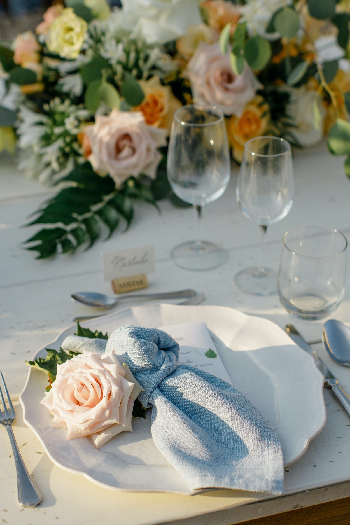 chambray napkins with rose on plate