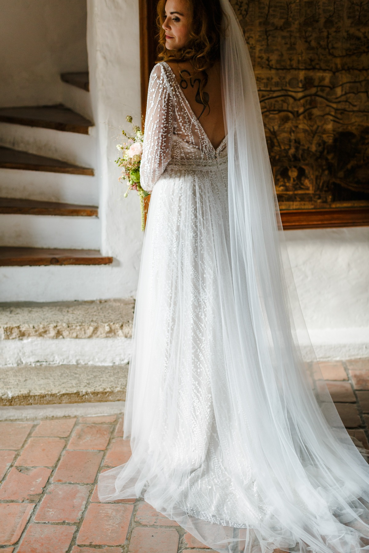 long sleeve wedding dress paired with long veil