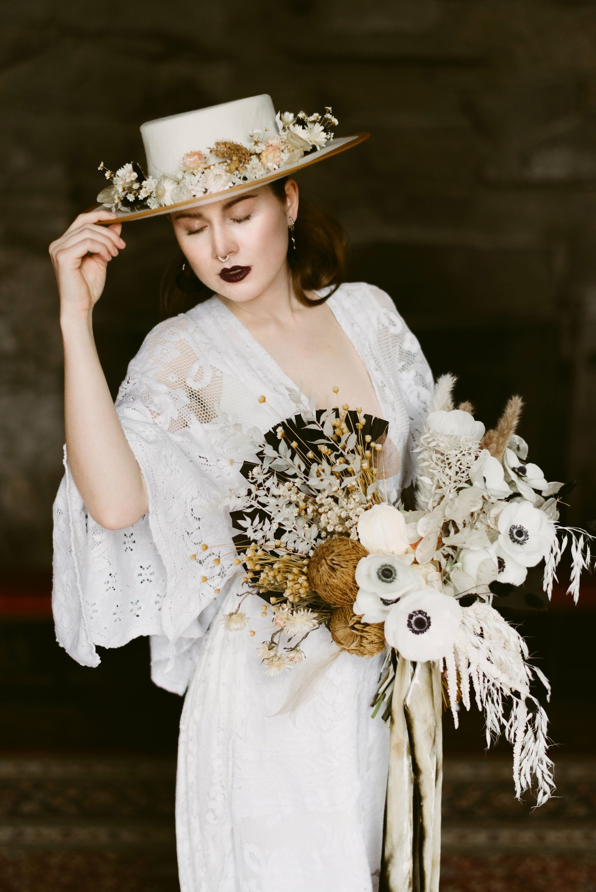 boho wedding dress paired with hat with dried florals