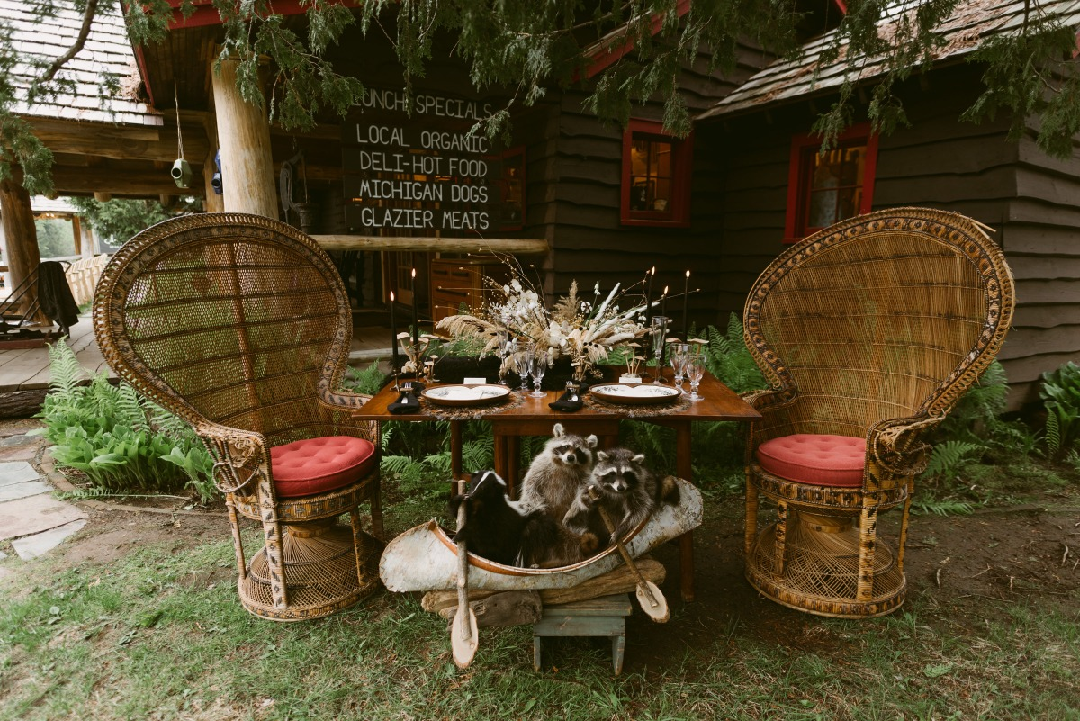 sweetheart table with rattan peacock chairs