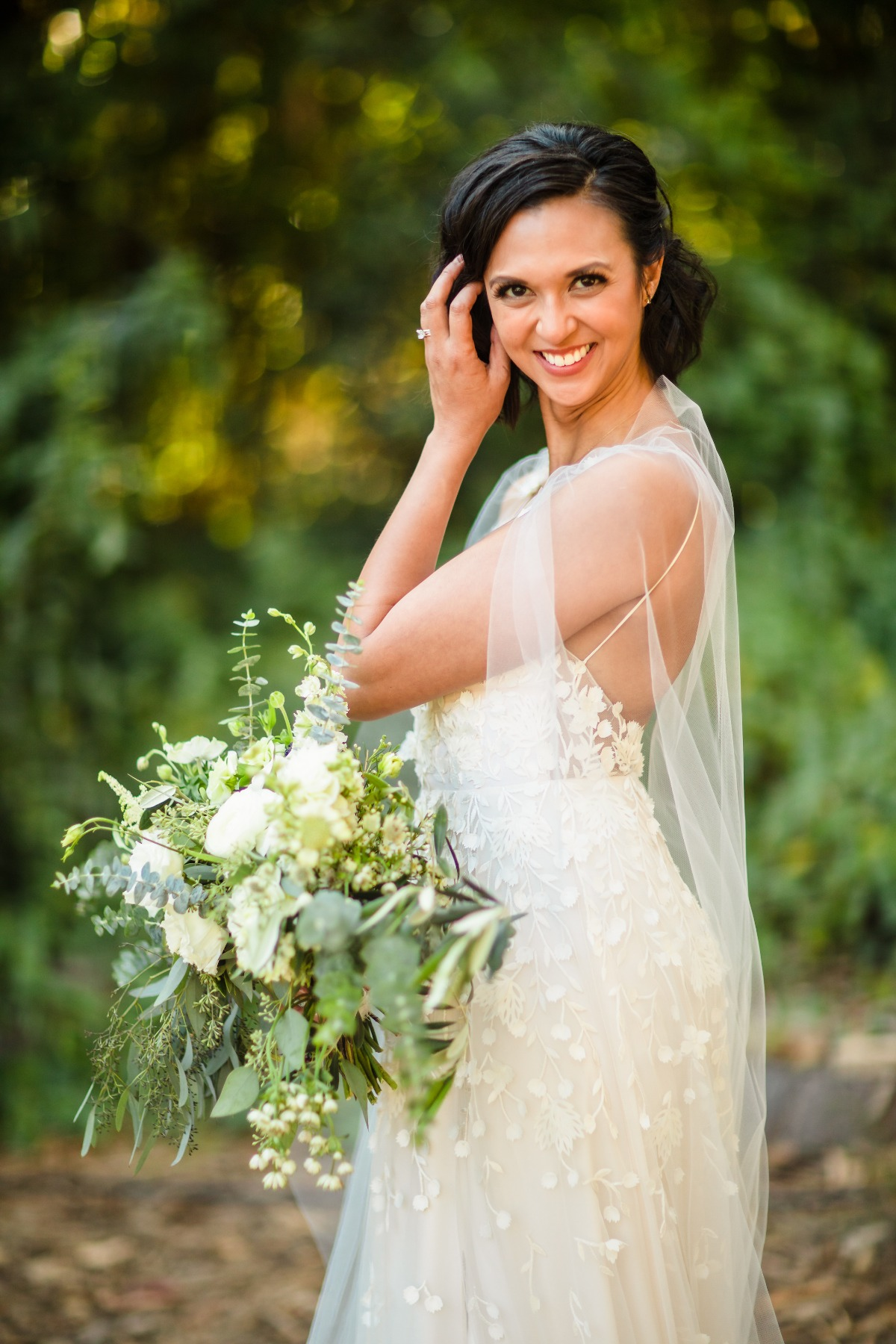 bride with white and green wedding bouquet