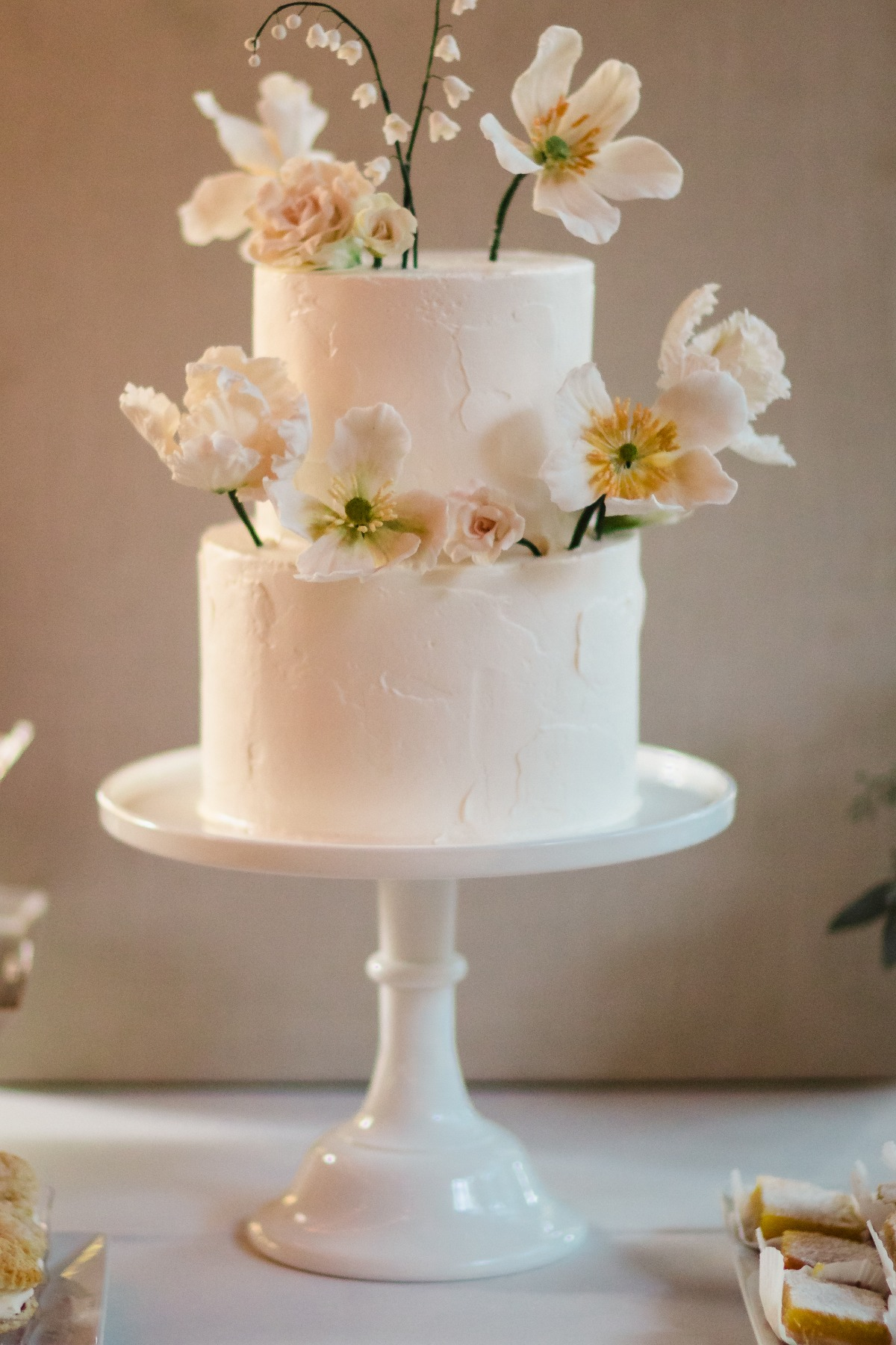 white wedding cake with sugar flowers from Lele Patisserie