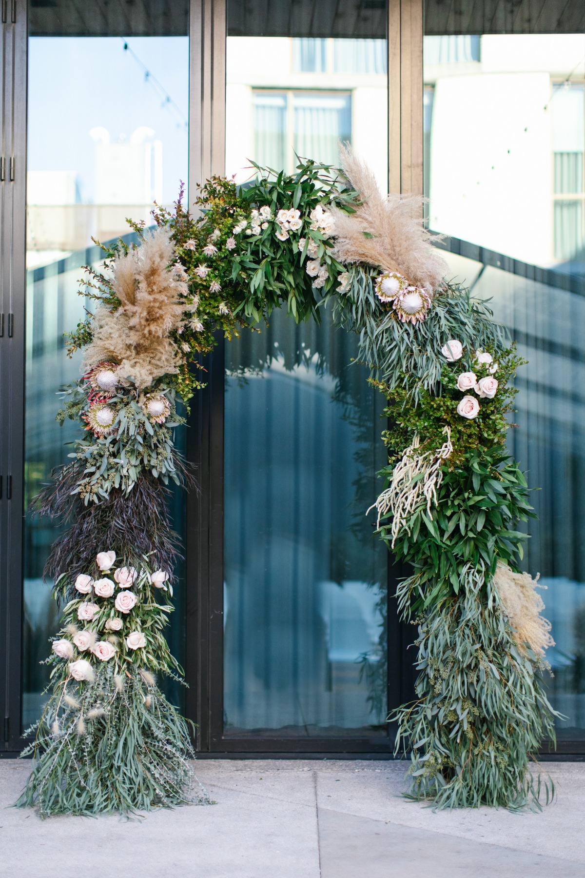 Wedding arch decorated with eucalyptus, protea and paps grass