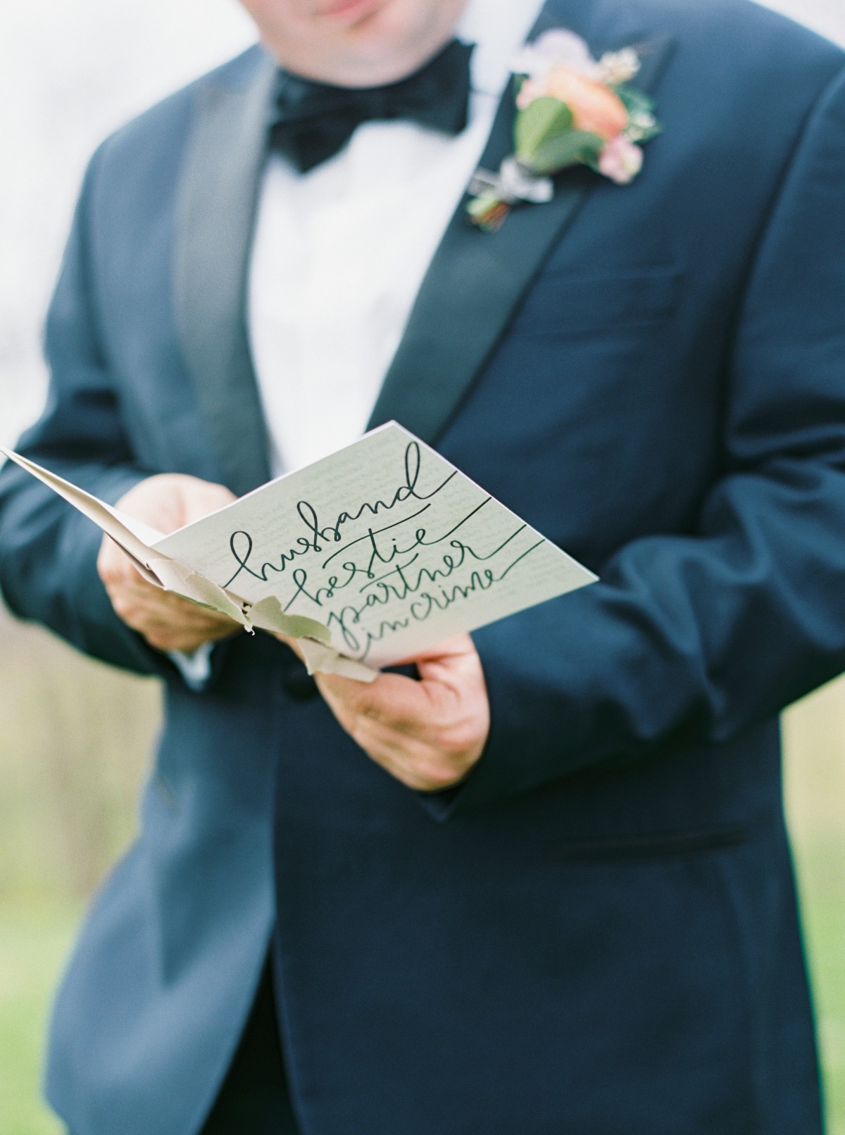 reading wedding card from wife