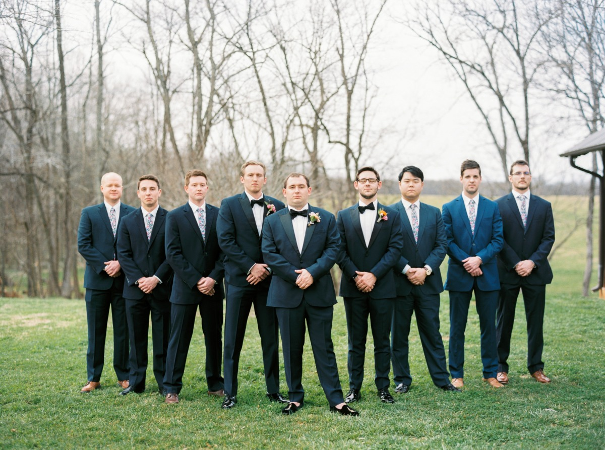 grooms in mismatched outfits