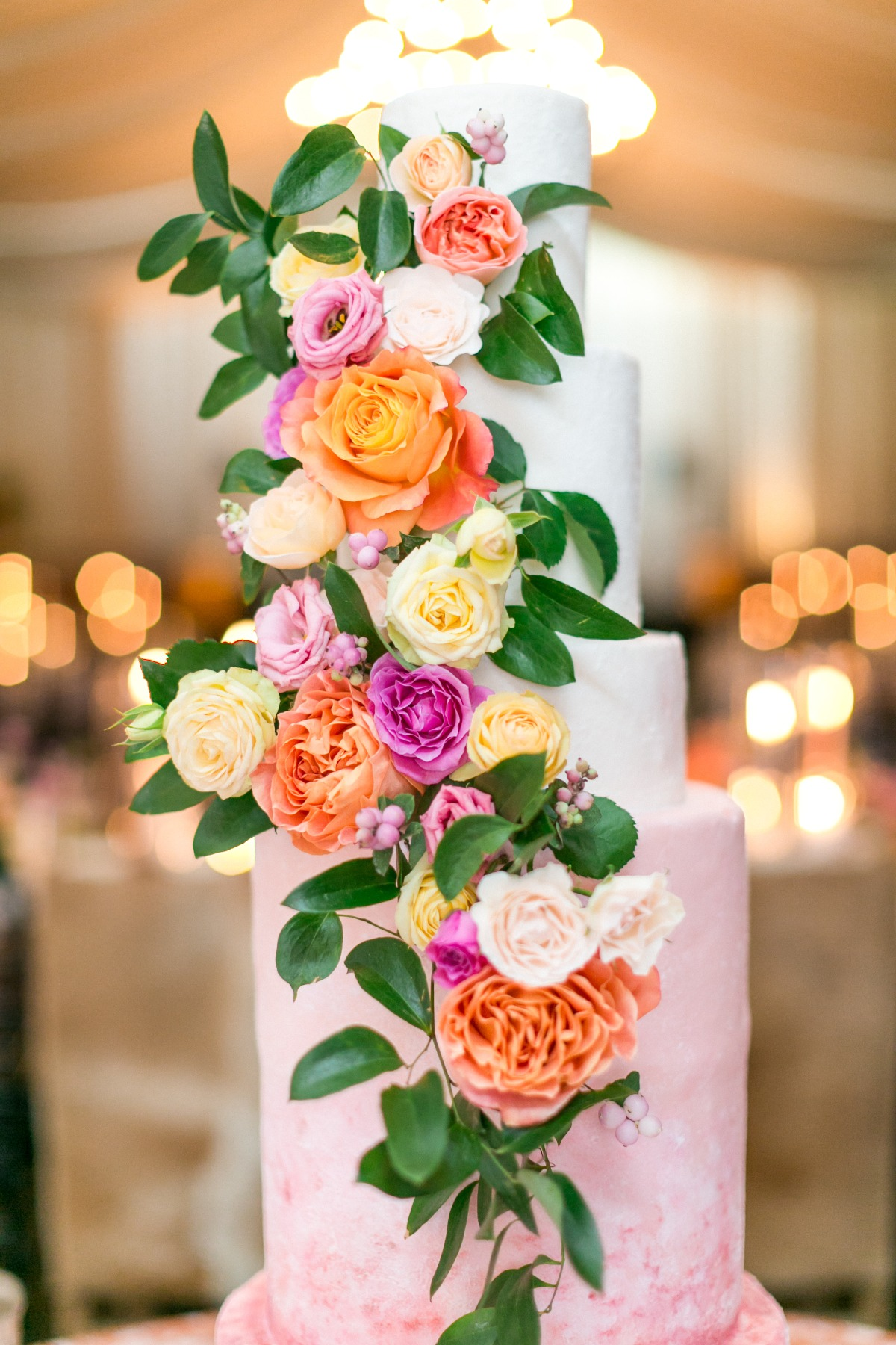 pink wedding cake with fresh florals
