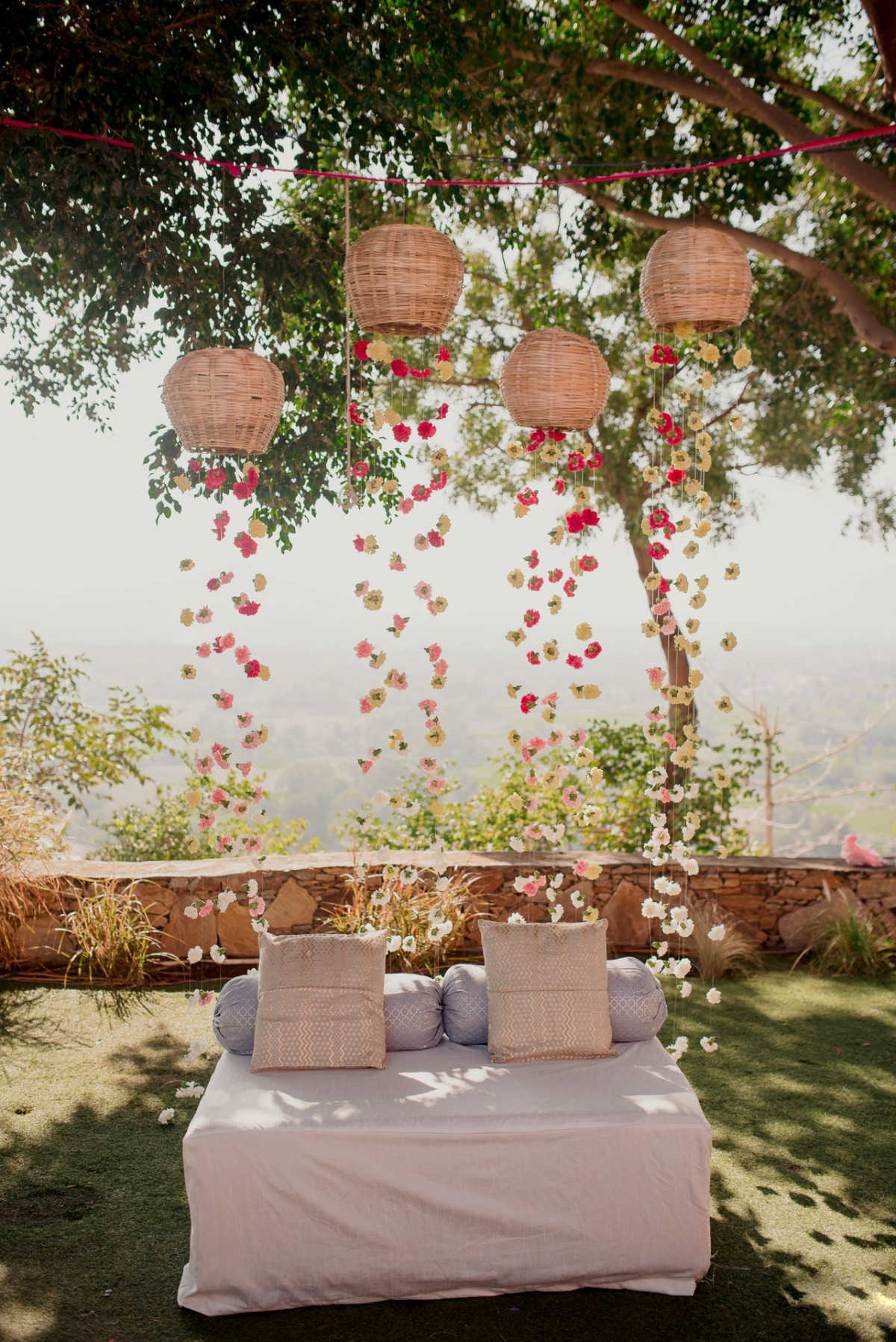wicker baskets with florals hanging from them