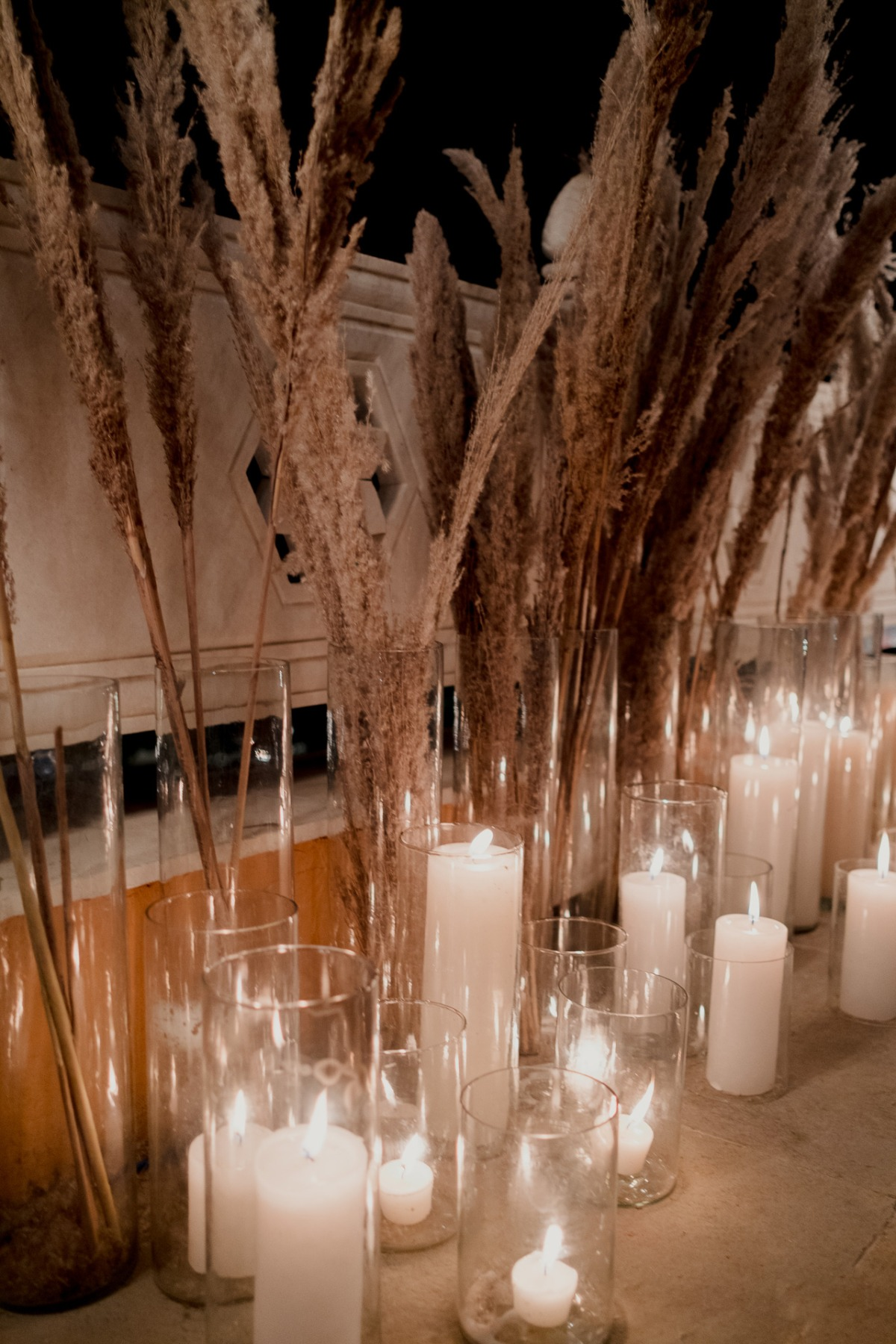 dried grasses and candles