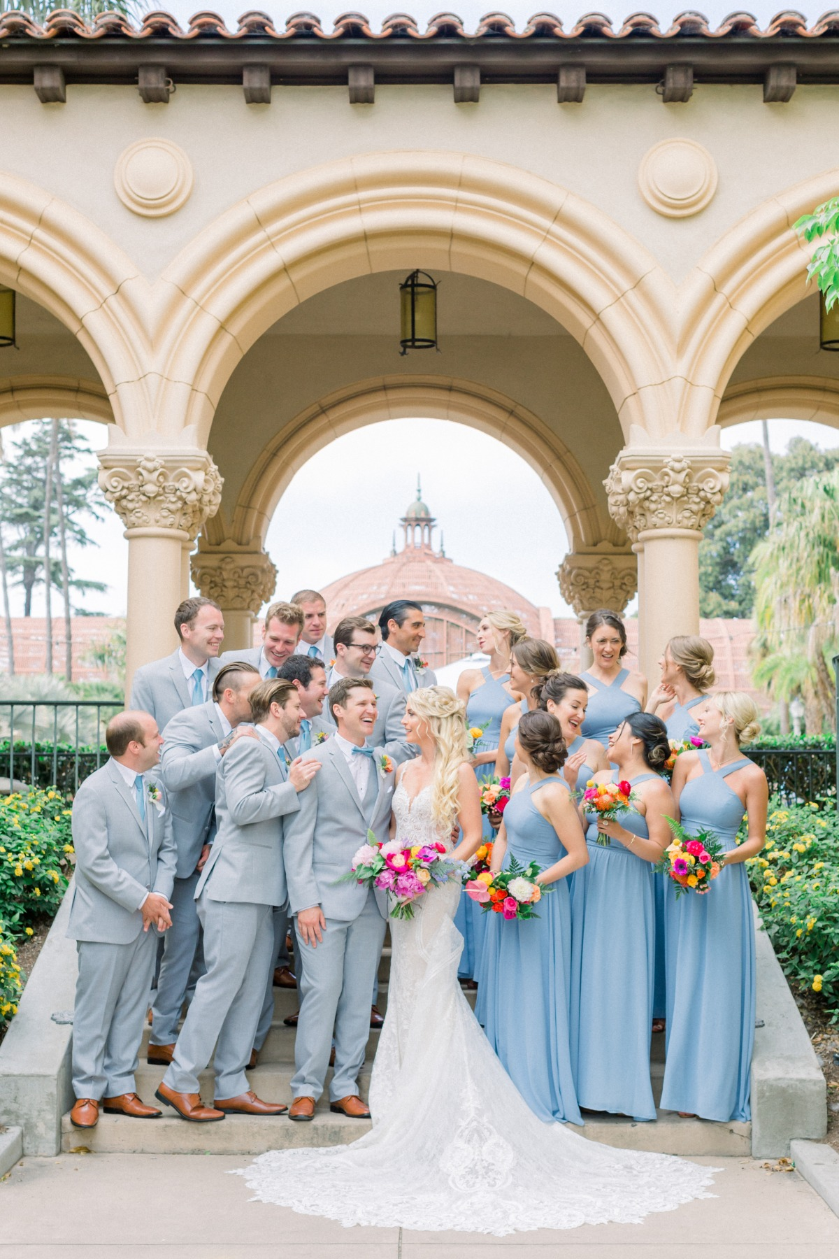 gray and blue wedding party with bright wedding bouquets