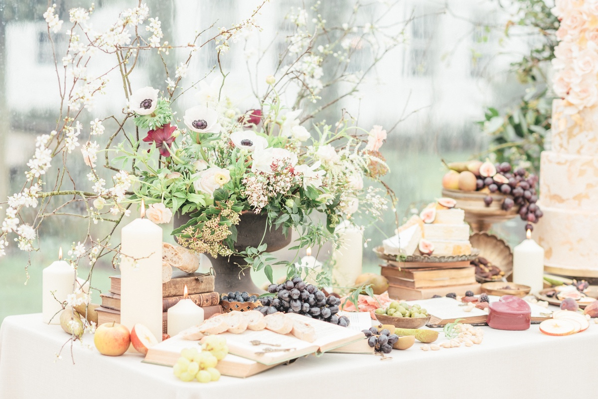 charcuterie table with wedding cake