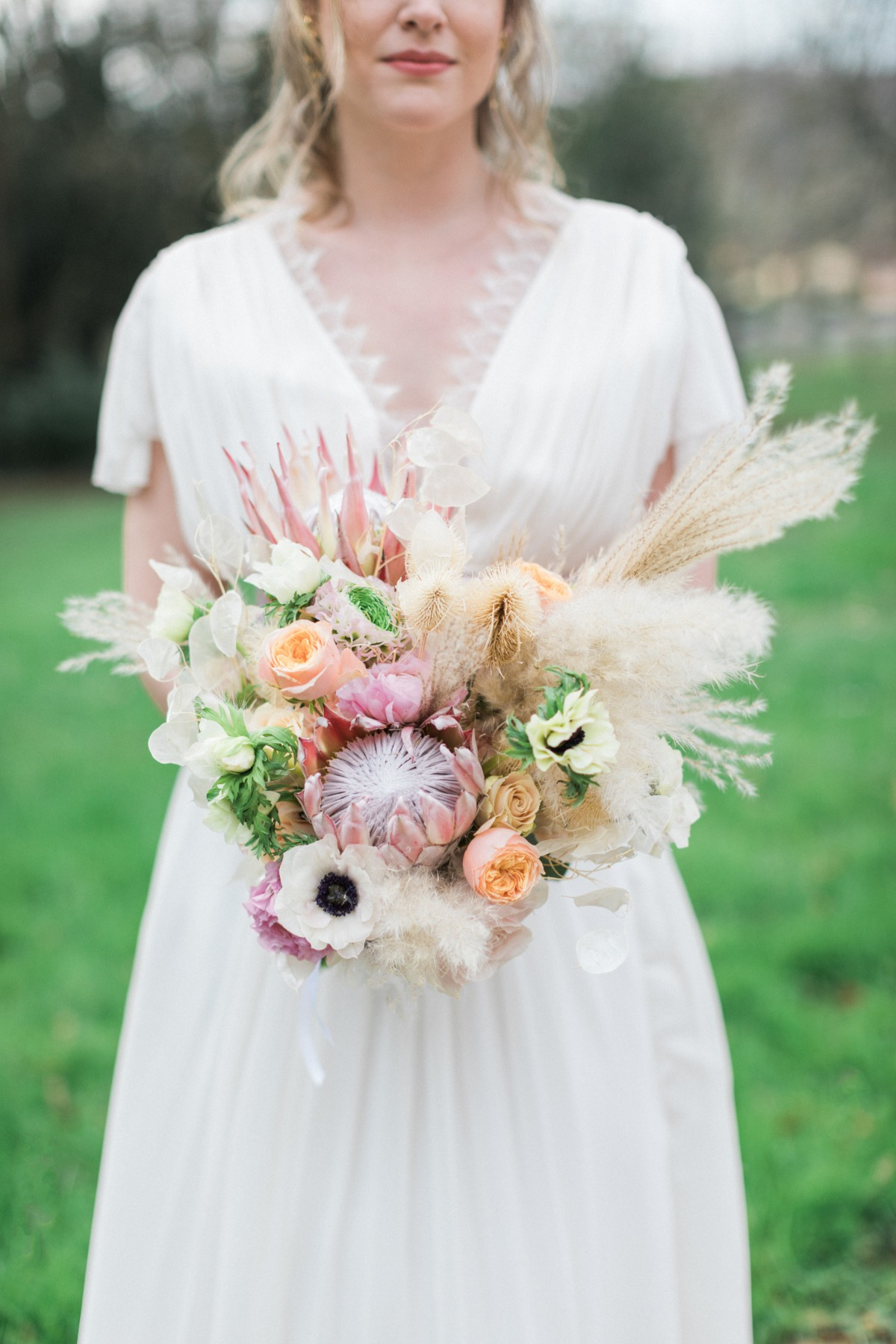 protea wedding bouquet with pampas grass