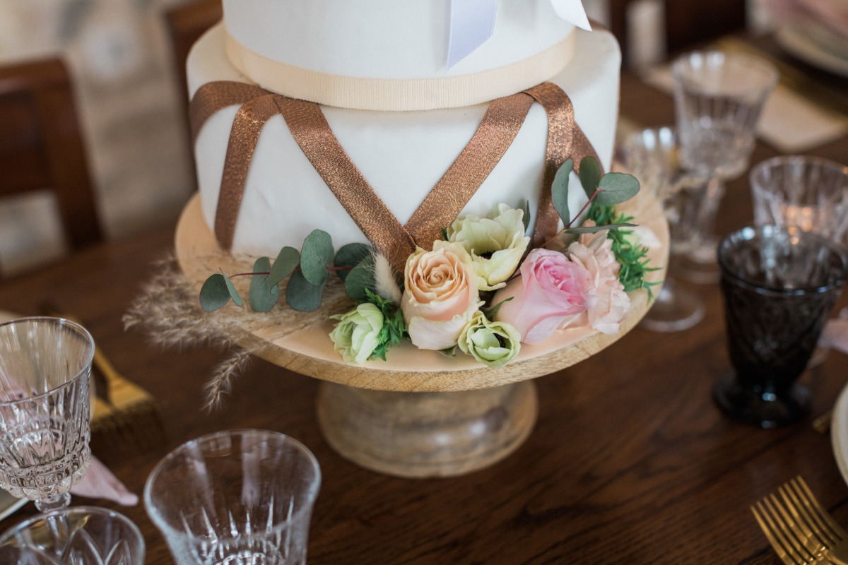 wedding cake with copper accents