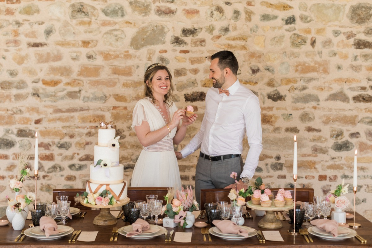 bride and groom and desert table