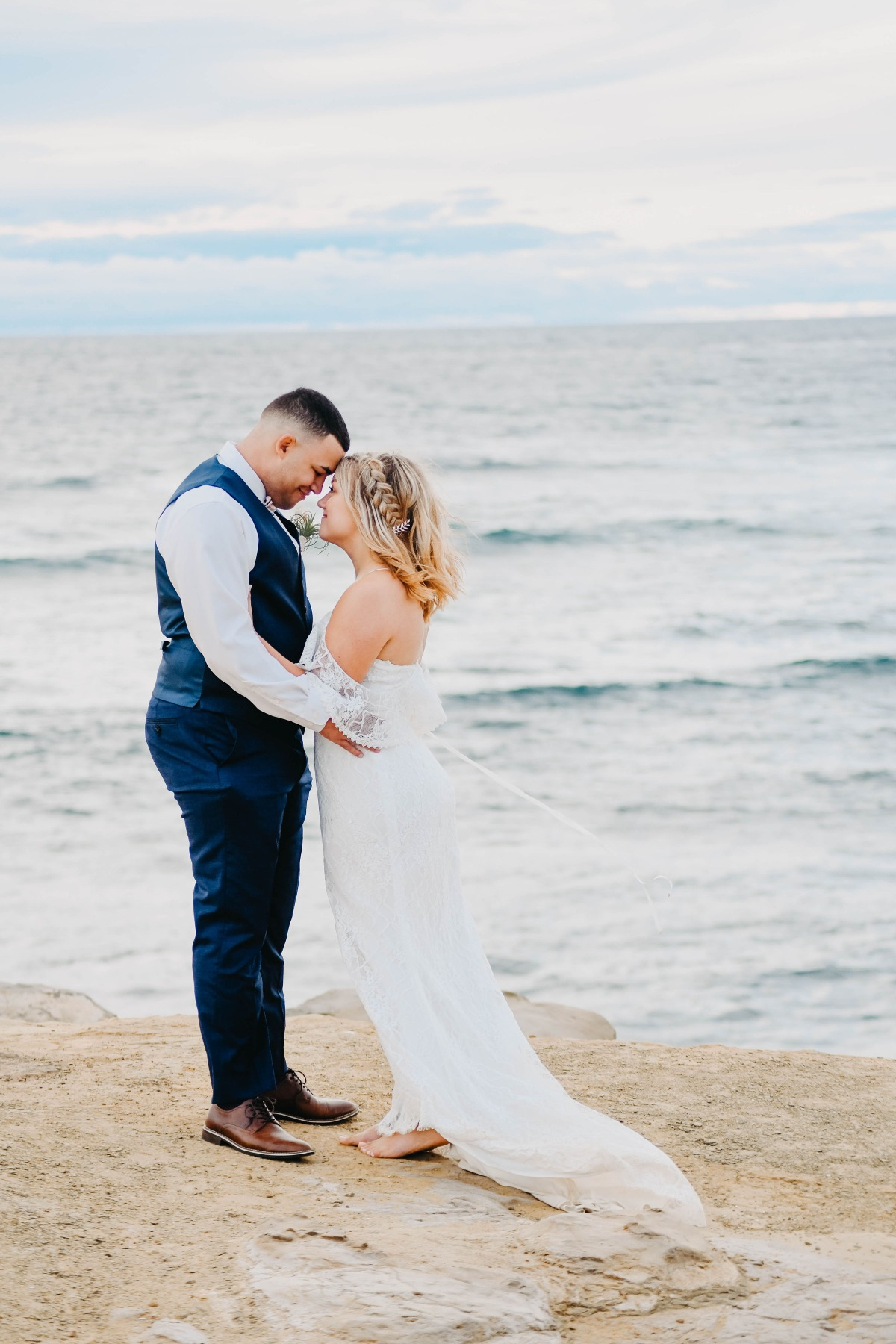 bride and groom on Sunset Cliffs at beach