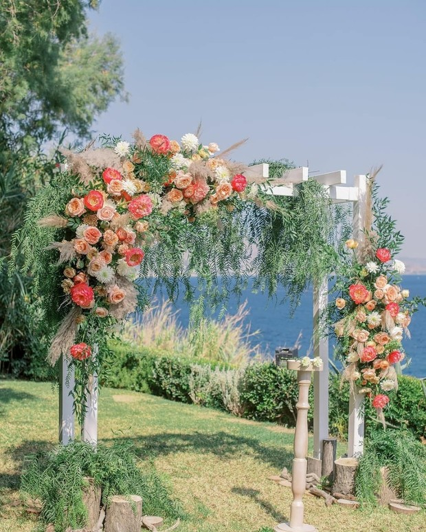 wedding back drop with peach and cream florals