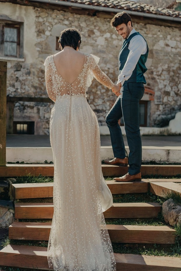 wedding dress with sleeves and low back