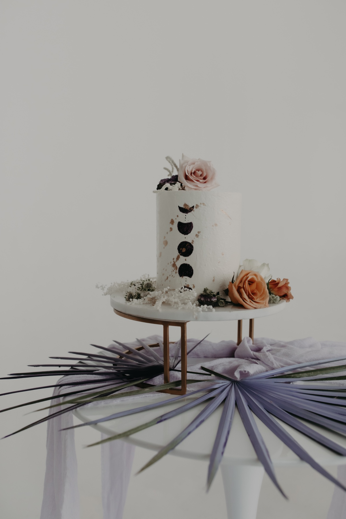 edgy wedding cake with dried flowers