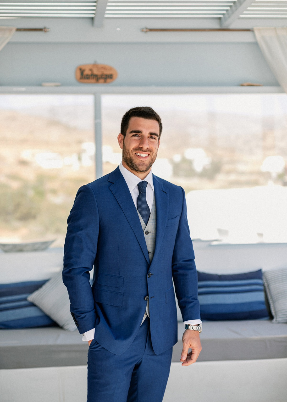 Groom in navy blue and gray suit