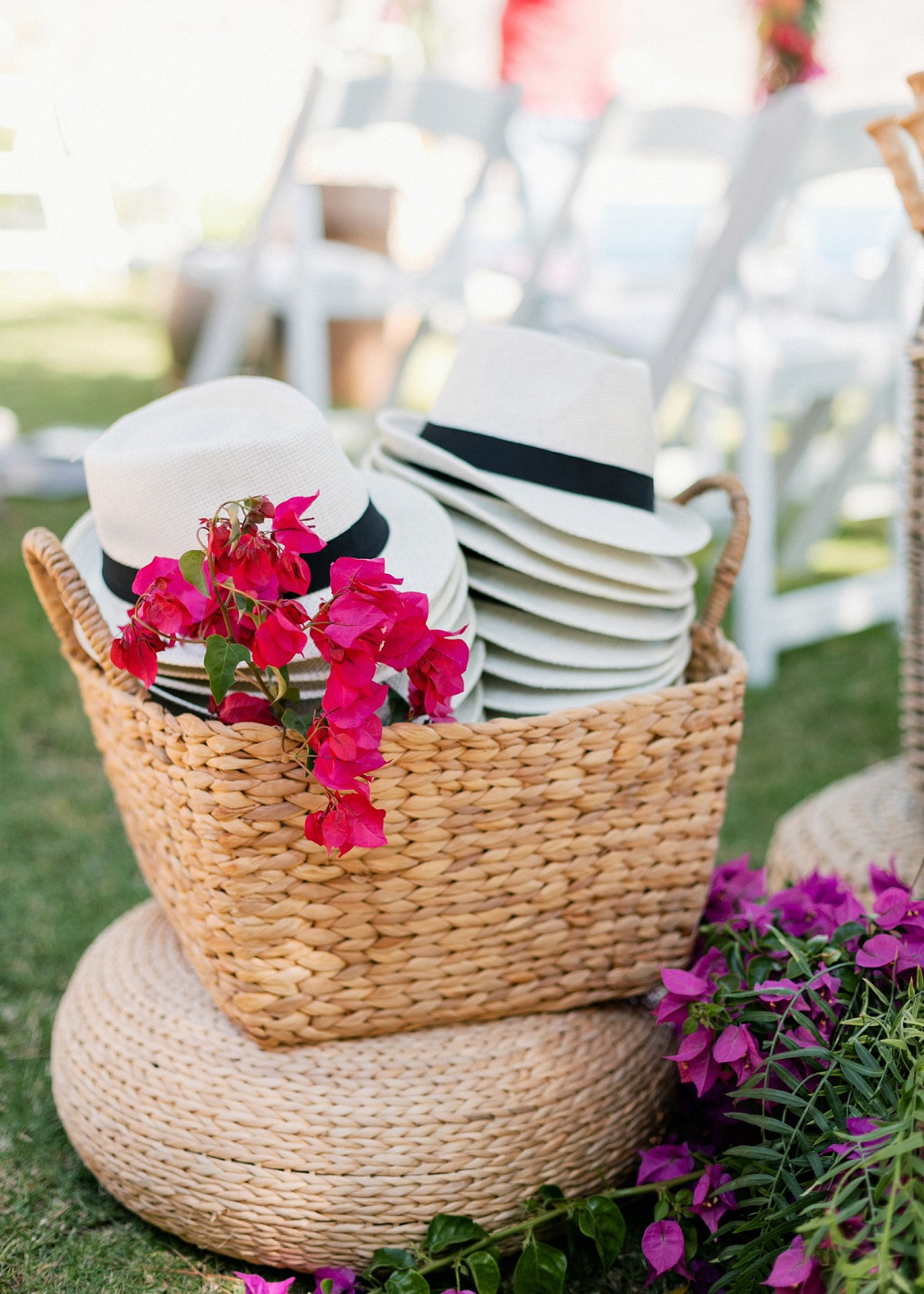 wooden fans, panama hats and parasols to cool off during the ceremony