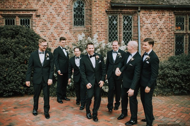 black groomsmen in tuxedos