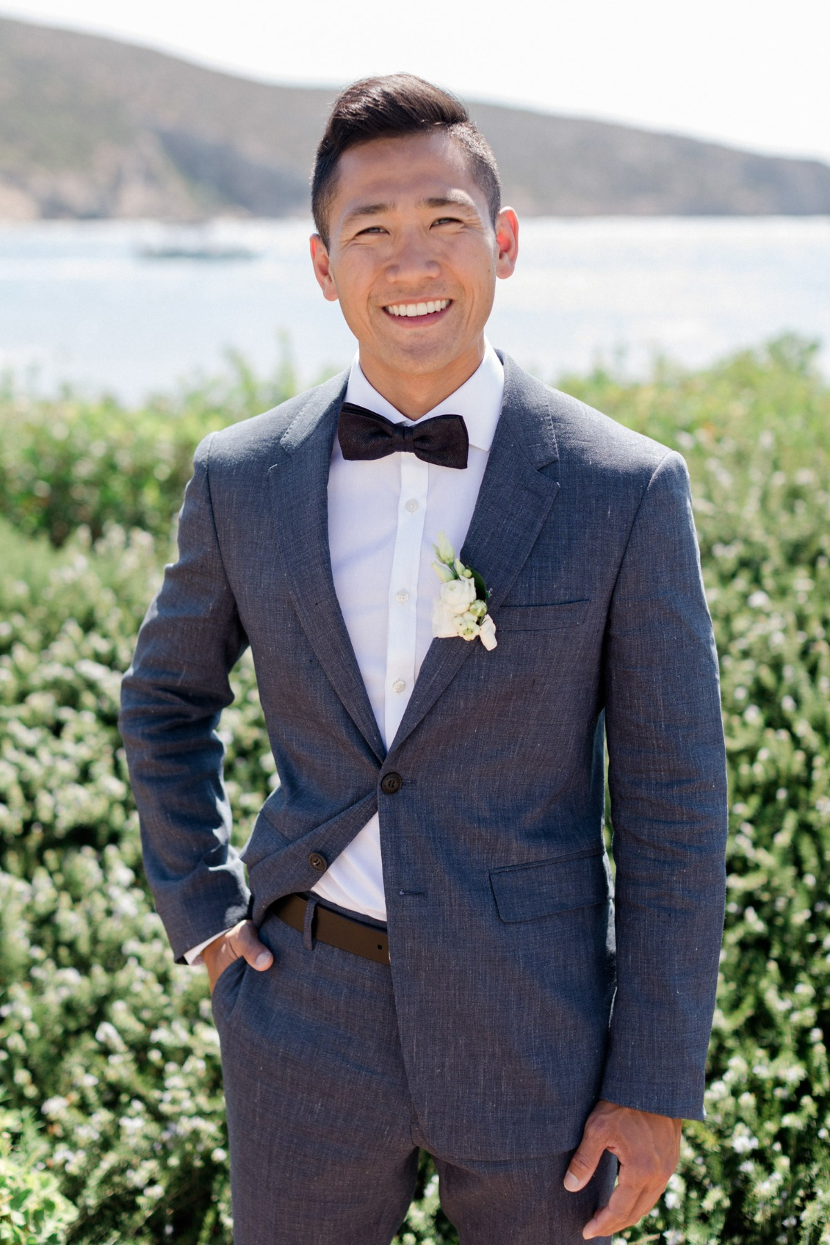 groom in bow tie suit