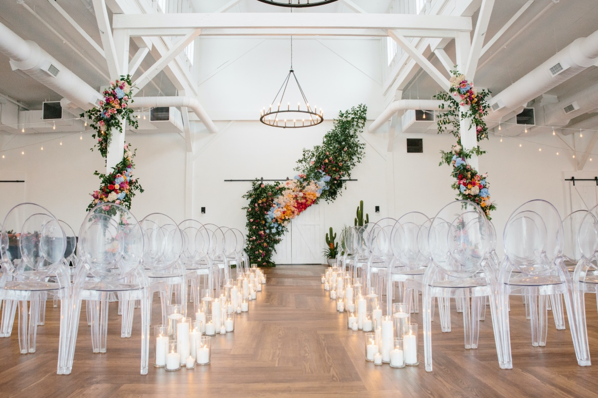 ghost chairs with a candlelit wedding aisle