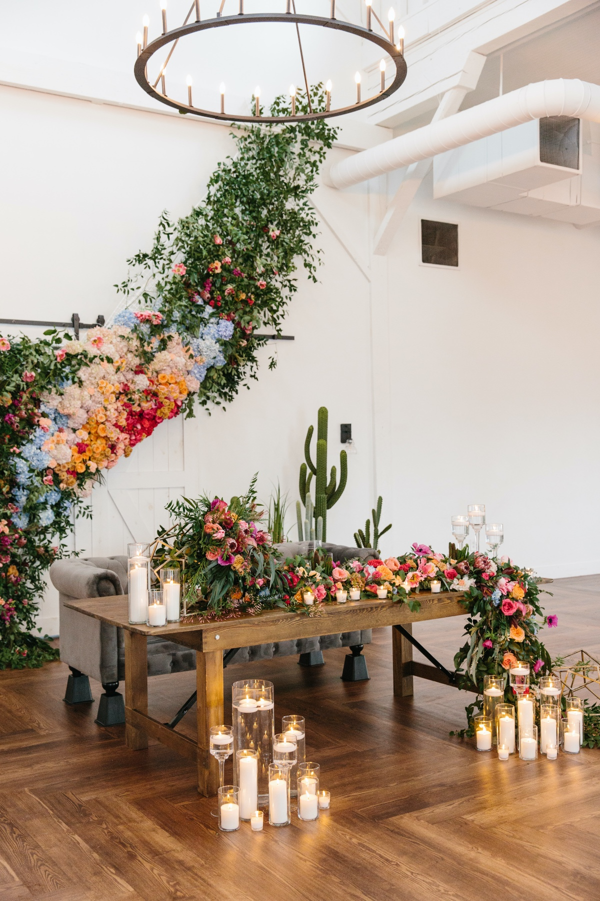 Sweetheart table design ideas with bright florals and candles