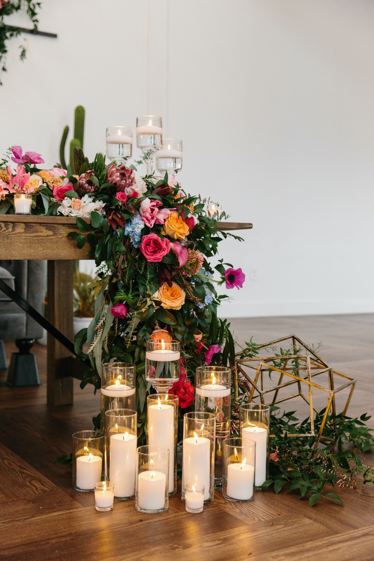 candles in front of sweetheart table