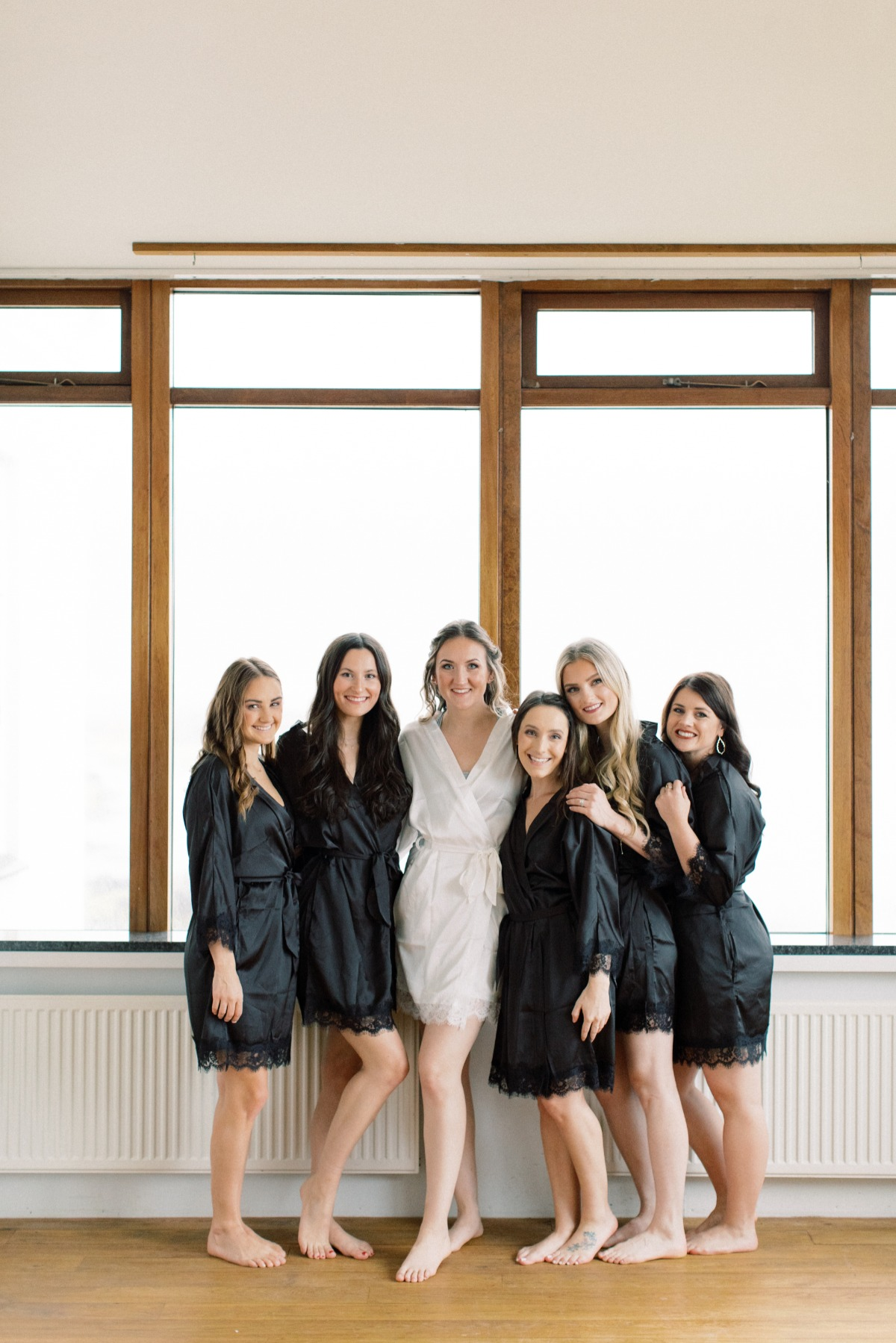 bridesmaids in black robes