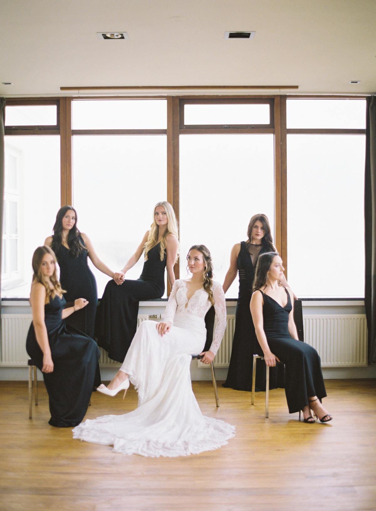 Bridesmaids in floor length black dresses