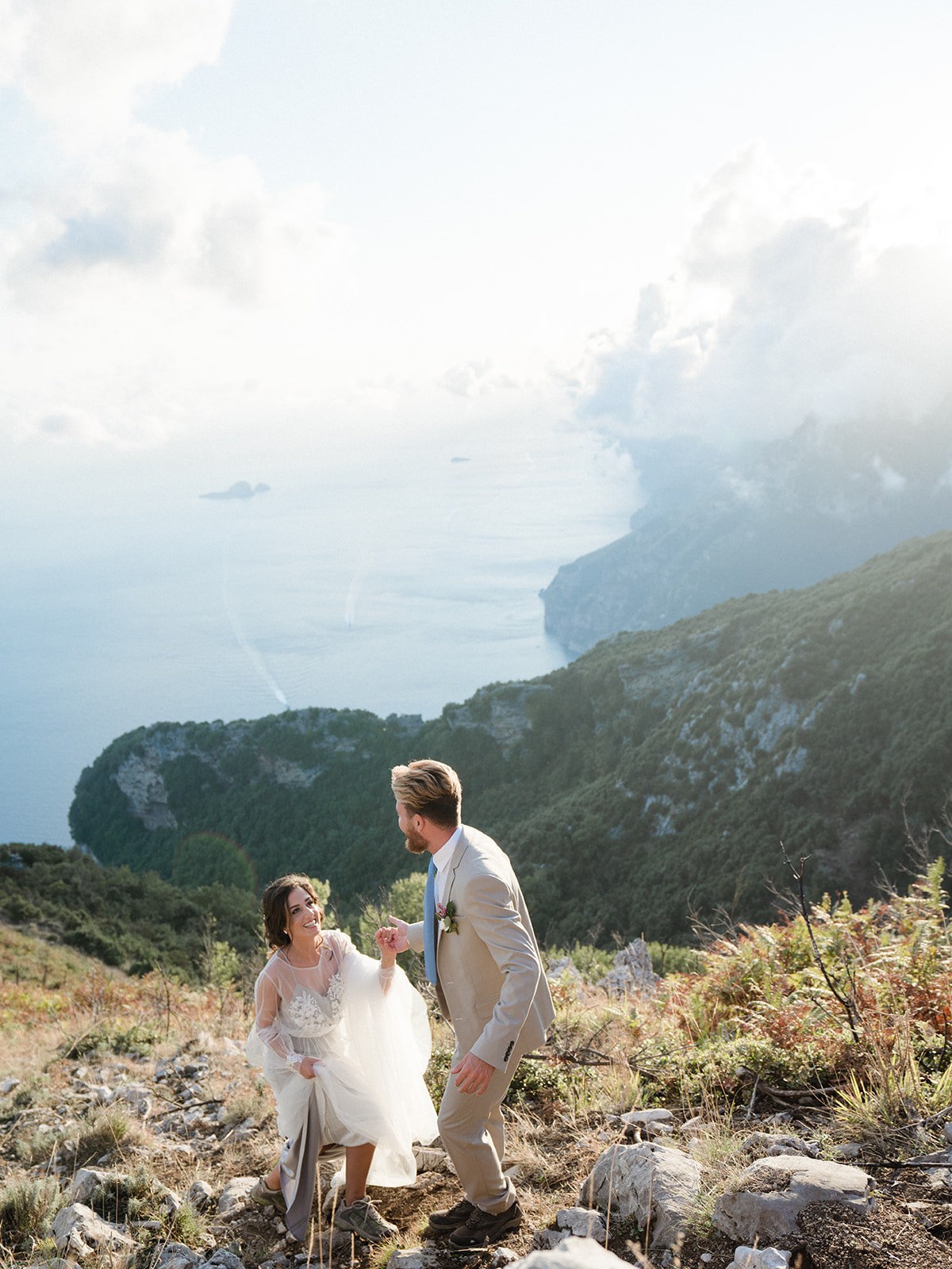 couple hikes up to The Path of the Gods for elopement