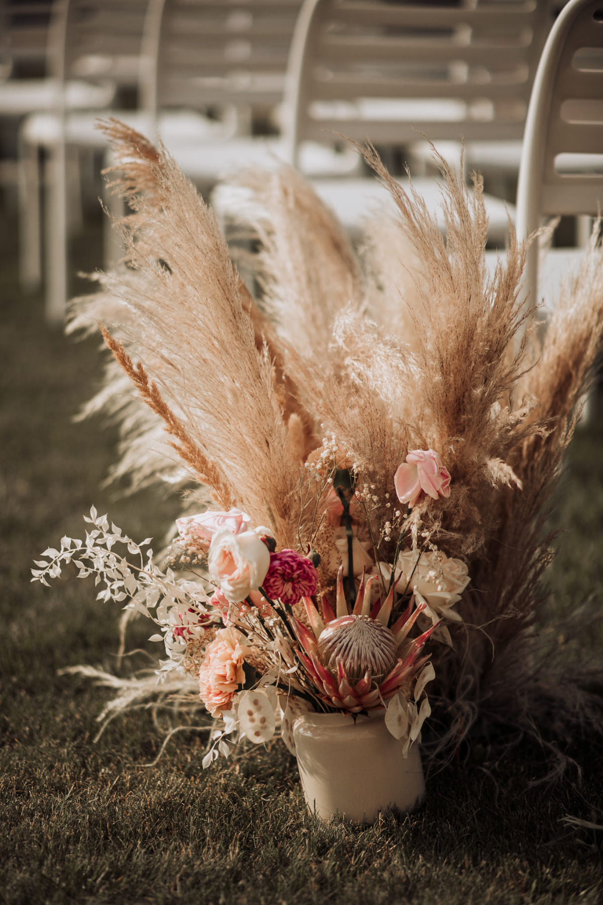 pampas grass aisle floral arrangement