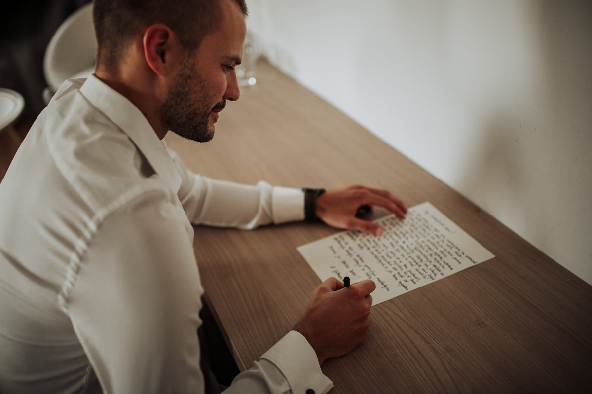 groom writing letter to his bride-to-be