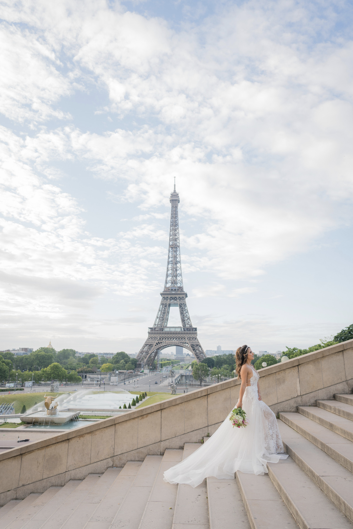 bride walking the stairs at her Paris elopement