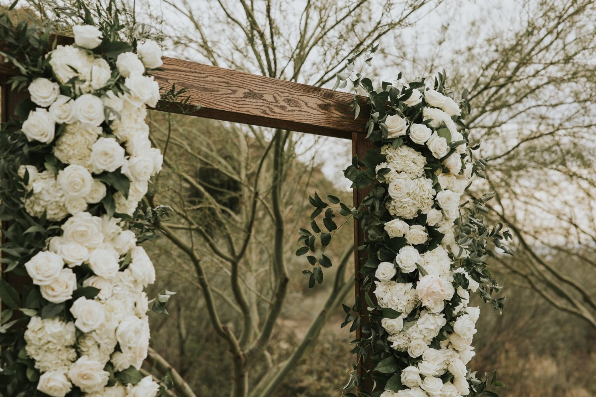 wedding ceremony backdrop adorned with florals
