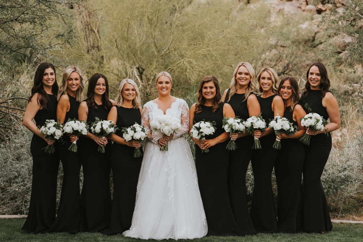 bridesmaid in floor length black dresses