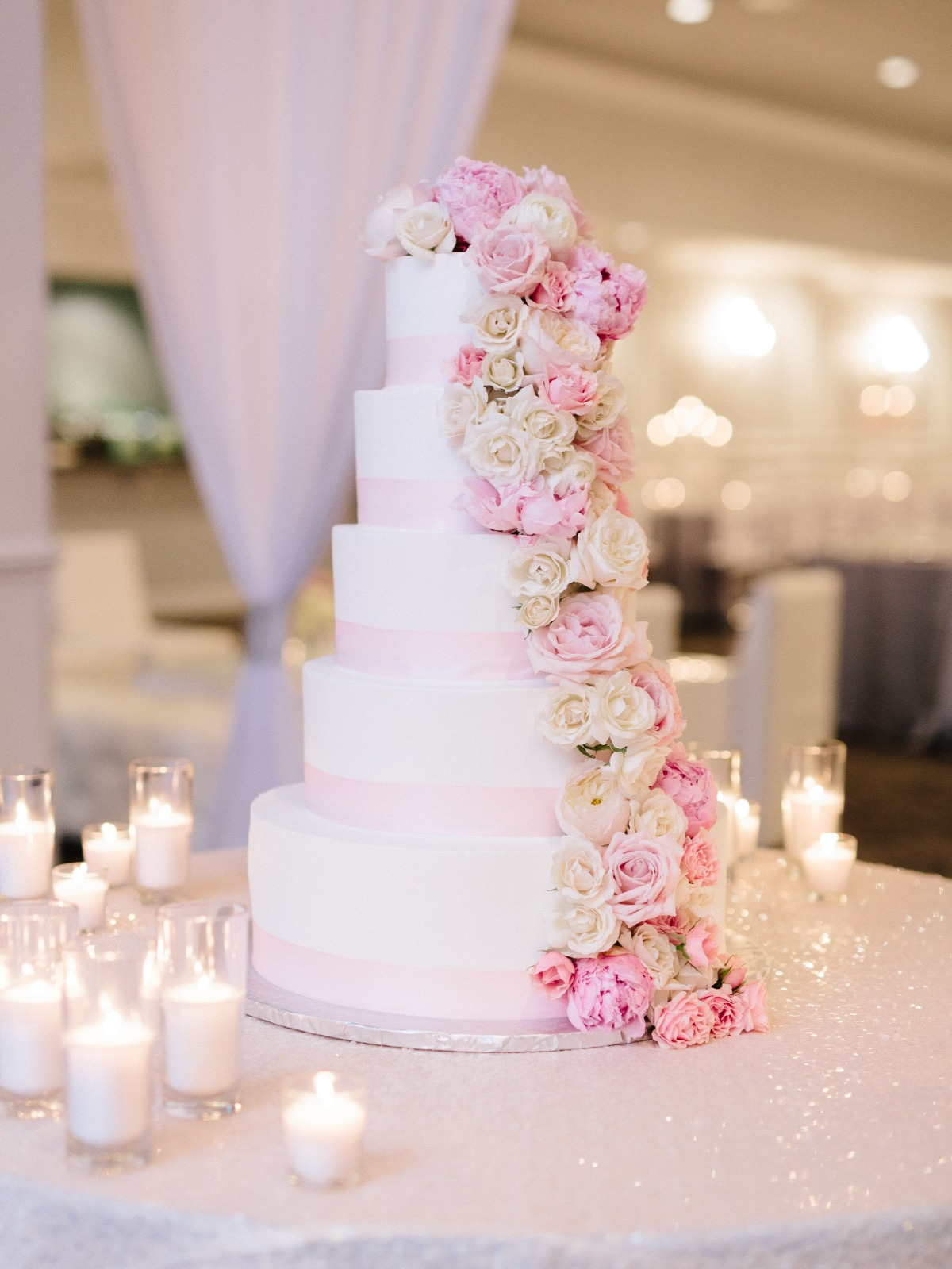 five layer wedding cake with cascading florals