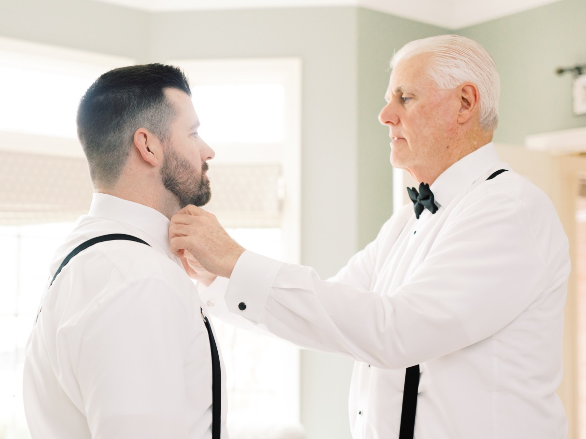groom getting wedding ready with his Dad
