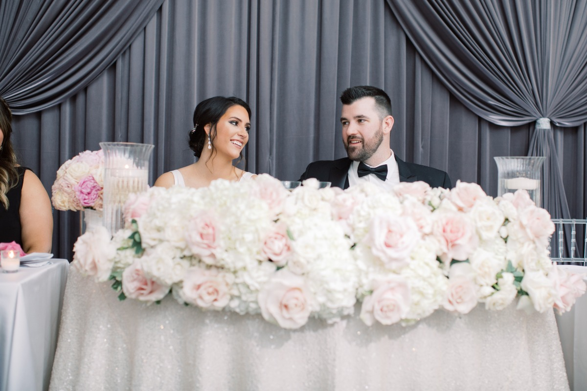 sweetheart table filled with florals