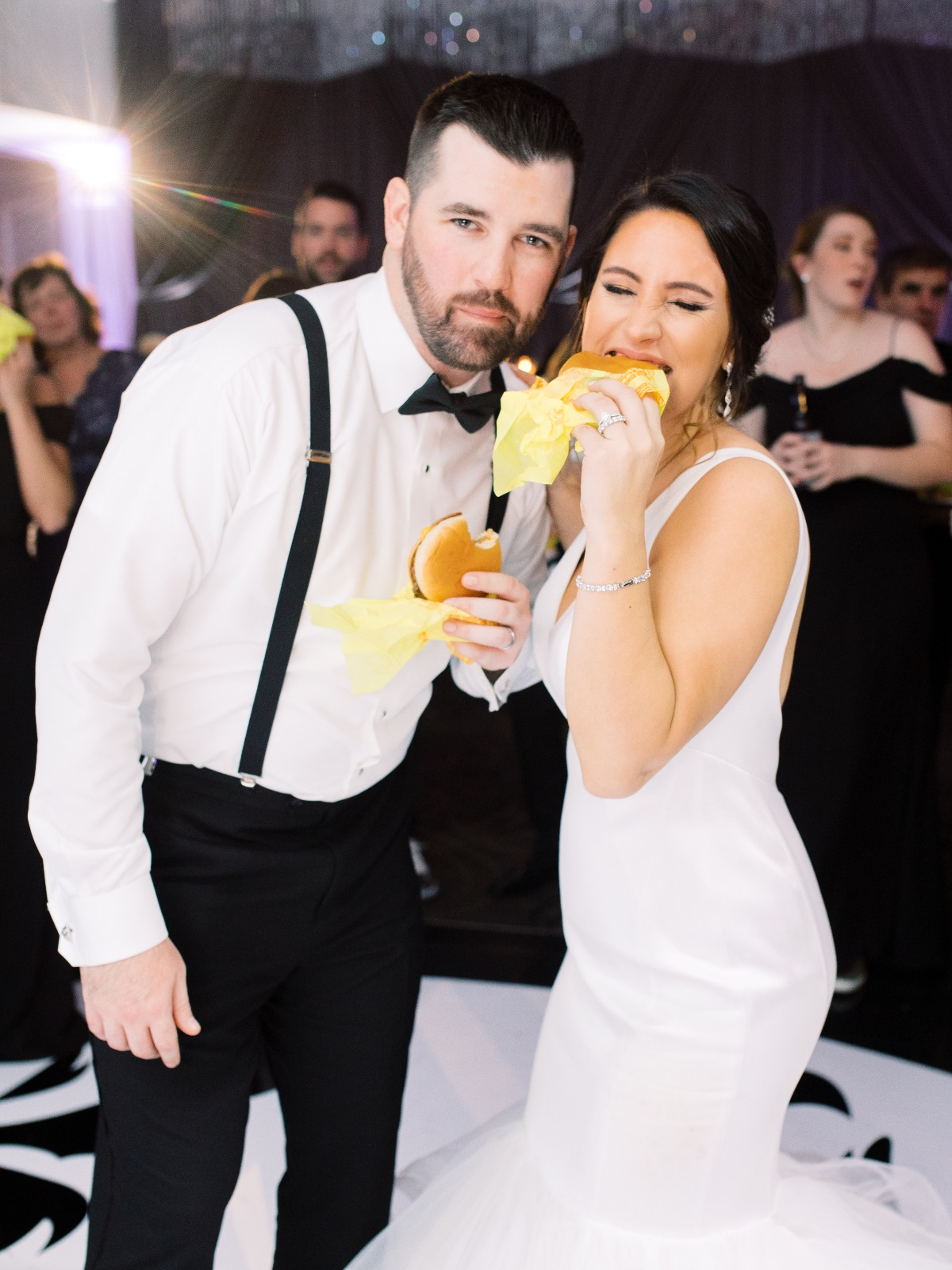 Bride and Groom Eating Cheeseburgers