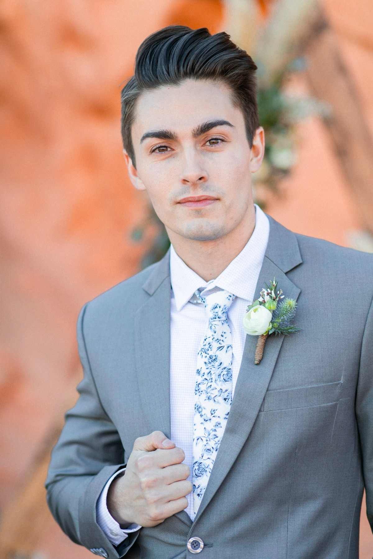grey groom suit with floral tie
