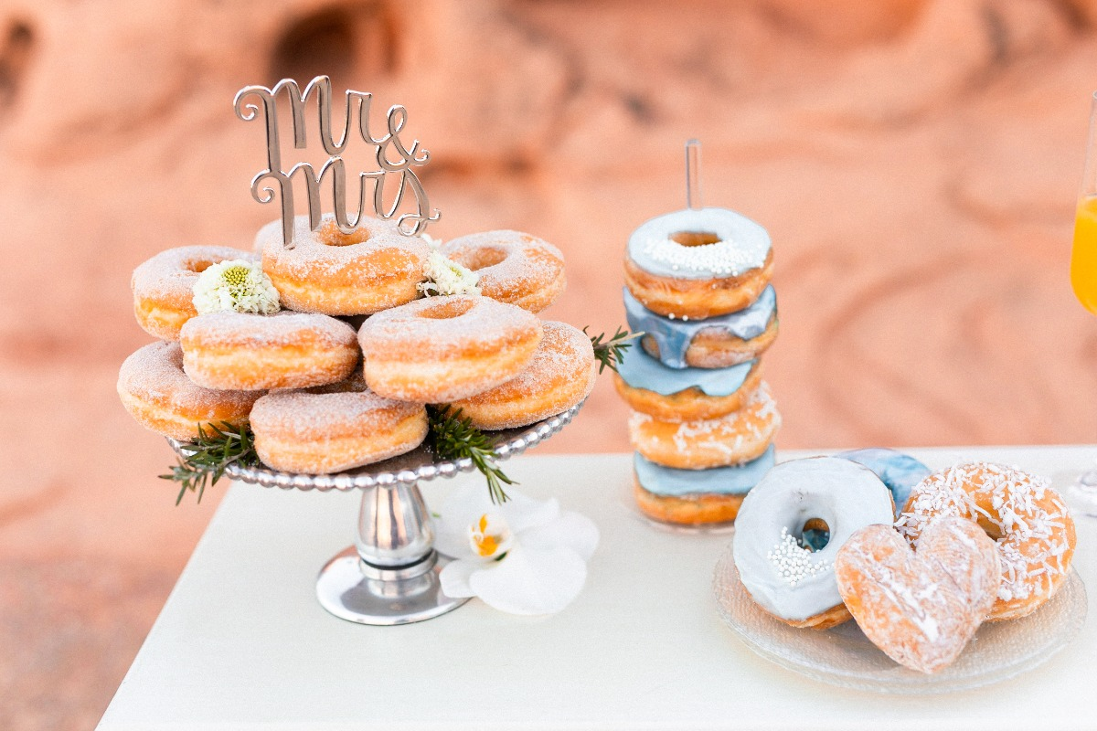 donuts with Mr. and Mrs. cake topper