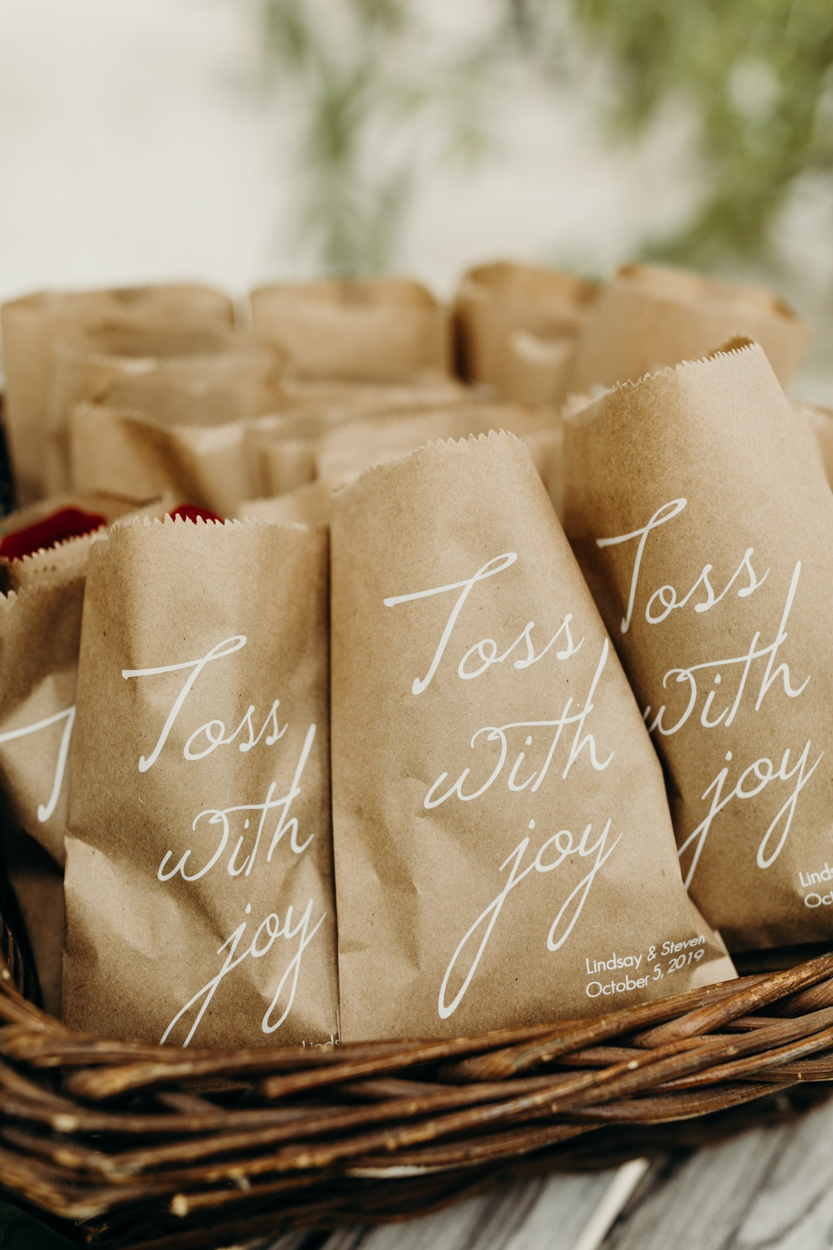 kraft wedding paper bags filled with roses to toss down the aisle
