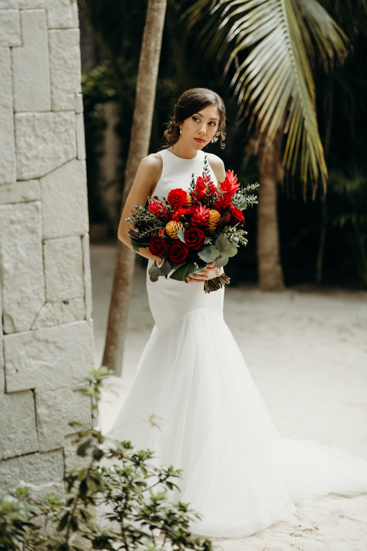 Mermaid wedding dress paired with tropical wedding bouquet