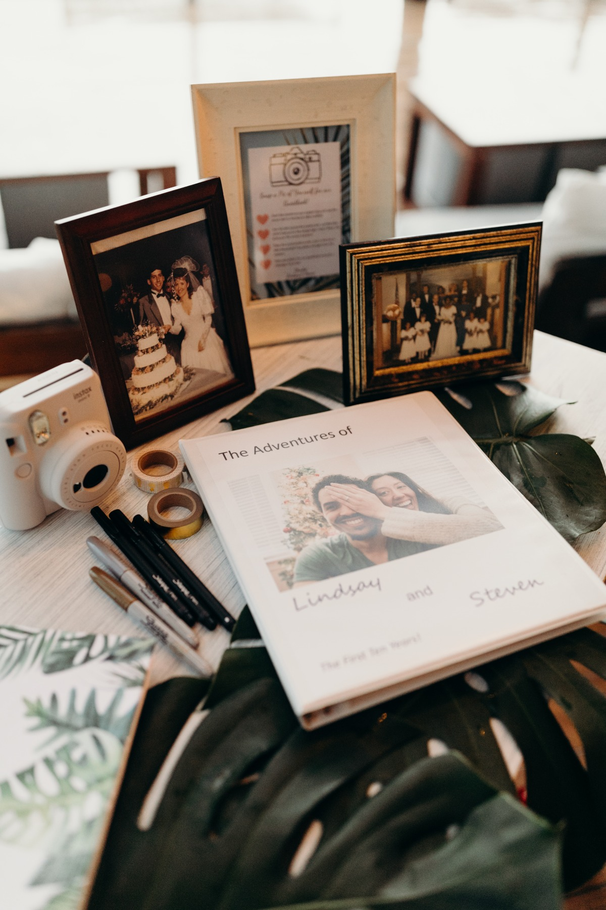 Guest book table with Instax camera and photo book to sign