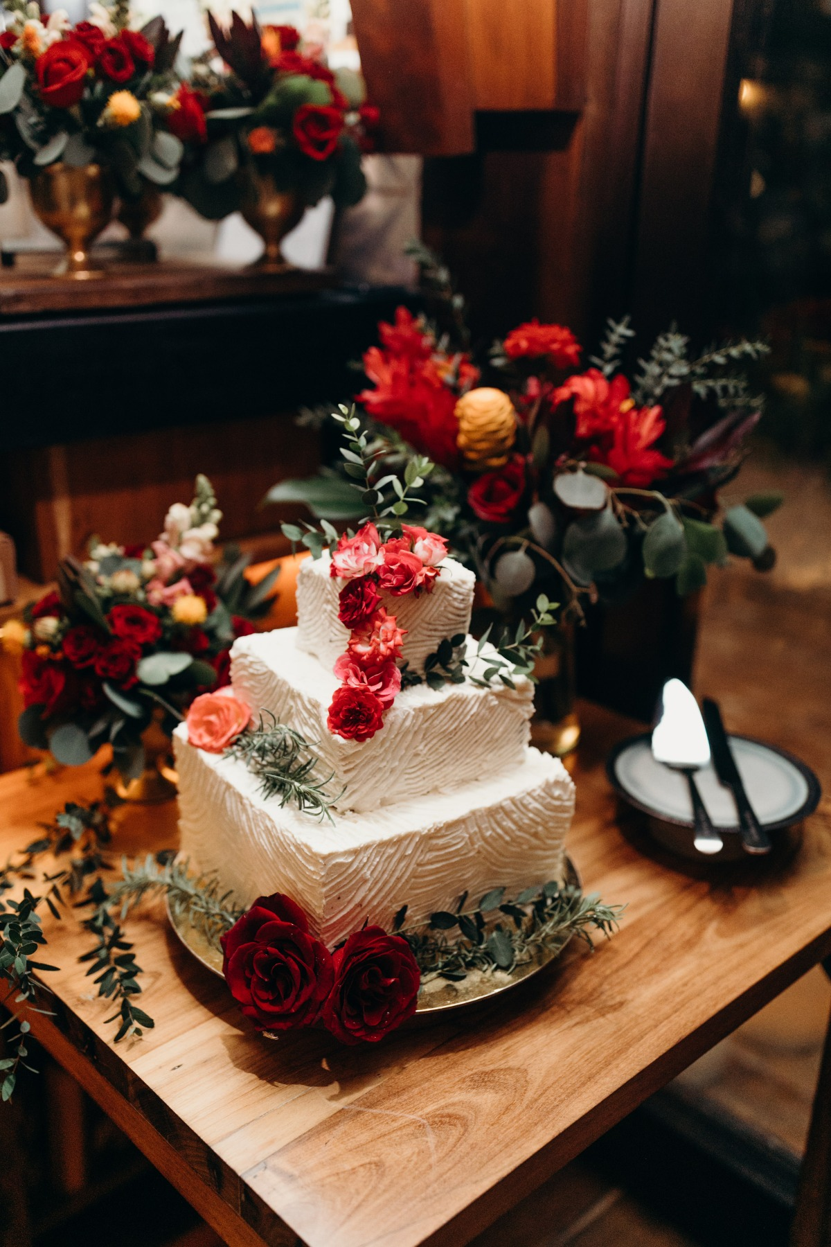 white wedding cake adorned with tropical florals