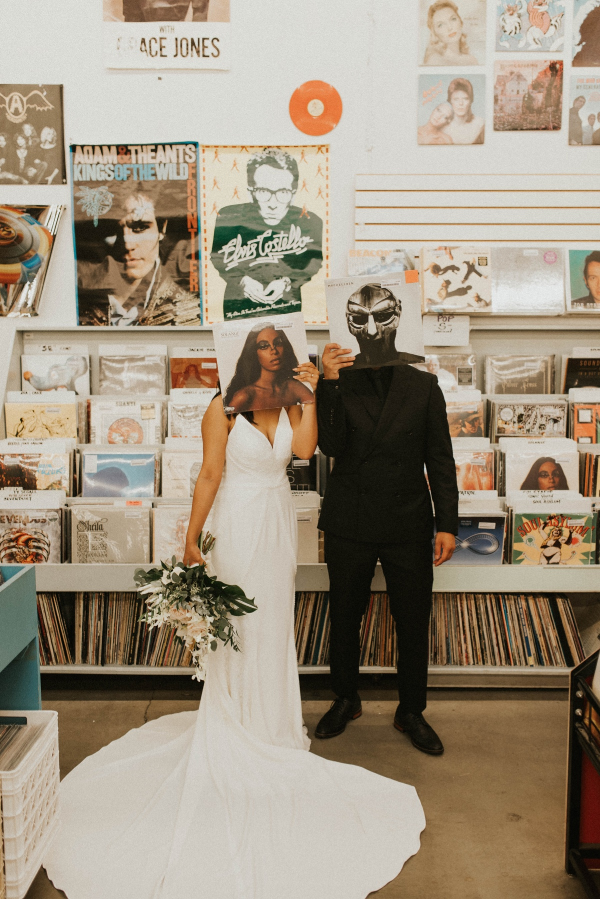 wedding party goes to record store on wedding day